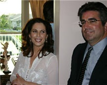 Diana and Dr. John Ortiz ( the firm's General Contractor) socialize with other guests while proudly displaying the office